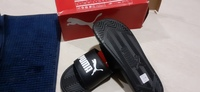 Used Puma slides for him in Dubai, UAE