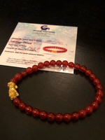 Used Certified solid Gold 24k and red Agate  in Dubai, UAE