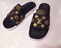 Used LV slippers size 42, new in Dubai, UAE