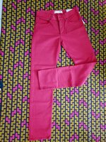 Used Red LACOSTE pants in Dubai, UAE