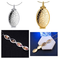Used Expanding Foto Locket necklaces silver&g in Dubai, UAE