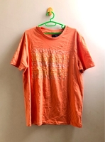 Used SUNSET light orange T-shirt  in Dubai, UAE