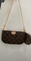 Used Lv multi pochette with coin purse in Dubai, UAE