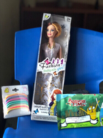 Used New fashion Barbie doll,wipes &hair band in Dubai, UAE