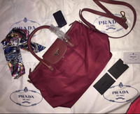 Used Prada Sling Bag (maroon color) in Dubai, UAE