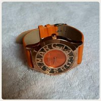 Orange rose gold watch.......