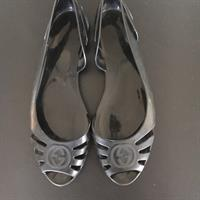 Used Gucci Black Flats. Open Toe. Rubber. Logo. Worn. Good Condition. Sz 37. Bought In London. in Dubai, UAE