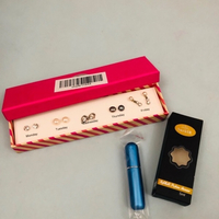 5 pairs of earrings + perfume atomizer