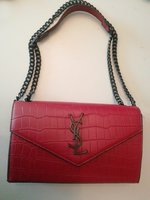 Used YSL sling bag designed red in Dubai, UAE