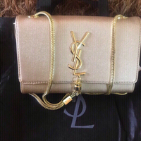 Used Golden Yves Saint Laurent handbag 👜  in Dubai, UAE