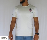 Used White T-shirt with a flower on the side  in Dubai, UAE