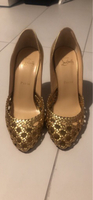 Used Louboutin brand new gold shoes size38.5  in Dubai, UAE
