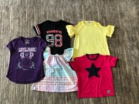 Used 5 T-shirts for a girl size 8-10 yo  in Dubai, UAE