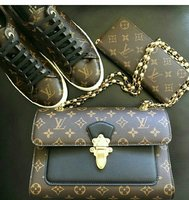 Used LOUIS VUITTON BAG AND WALLET in Dubai, UAE