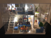 Miniature dollhouse with real lights.