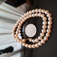 Used 18k gold pink pearls necklace in Dubai, UAE