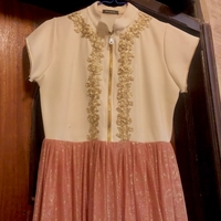 Used Gold and pink large dress  in Dubai, UAE