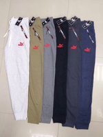 Used assorted puma, adids trouser 6 pcs large in Dubai, UAE