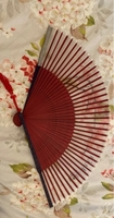 Used Japanese fan with red tassel and graphic in Dubai, UAE