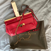 Used Charles & Keith red leather bag in Dubai, UAE