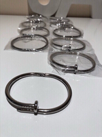 Used 10 pcs Nail shape cuff bangles silver  in Dubai, UAE
