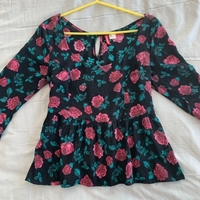 Used Peplum top fits small size for 30 dhs  in Dubai, UAE