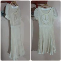 Used Elegant biege Dress for her small size. in Dubai, UAE
