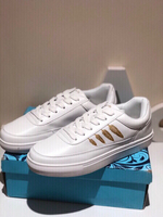 Used New sports shoes size 40 white with gold in Dubai, UAE