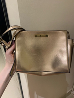Used Steve Madden bag in gold color in Dubai, UAE