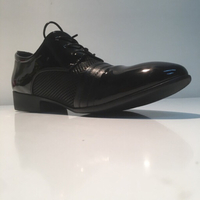 Officials shining shoe for man