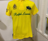 Used Authentic polo T-shirt yellow (M) in Dubai, UAE