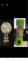 Used Portable juicer with rose gold watch new in Dubai, UAE