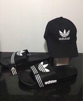 Used Offer: Adidas slippers 43 and cap, new in Dubai, UAE