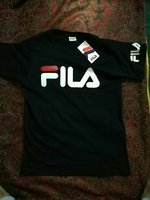 Used Fila shirt new size, M, L black colour in Dubai, UAE