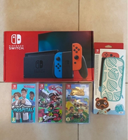 Used Nintendo switch + 3 games and case in Dubai, UAE
