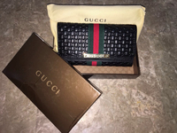 Gucci Wallet,new,not used.black,comes With Dust Bag And A Box.master Copy