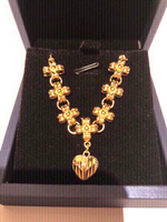 Used 18k gold plated bow charm with heart pendant in Dubai, UAE