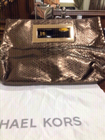 Used Mk clutch Authentic preloved in Dubai, UAE