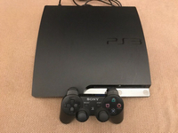 Ps3 with a joystick and 5 games.