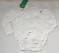 Used 2-pack cotton long-sleeved bodies, 6-9M in Dubai, UAE