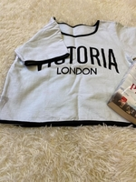 Used White t-shirt with a name logo  in Dubai, UAE
