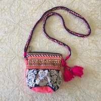 embroidered bag with tassels and beads