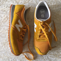 Used NEW BALANCE mustard trainers (size 39.5) in Dubai, UAE