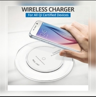 Used New white wireless charger Qi compitable in Dubai, UAE