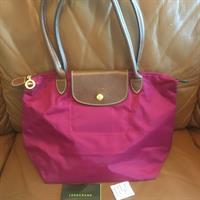 Used Longchamp Le Pliege In Magenta Color, Made In France, Carecard Included in Dubai, UAE