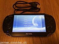 Used Ps vita console with games and mc in Dubai, UAE