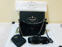 Used Prada Sling Bag with small purse in Dubai, UAE