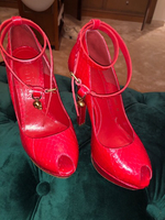 Used Alexander Mcqueen red python shoes  in Dubai, UAE