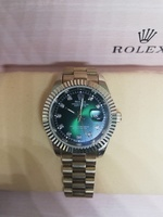 Used Rolex Gold/Green Watch Unisex in Dubai, UAE