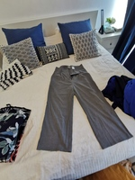 Used H&m pants (short) with belt size 44 in Dubai, UAE